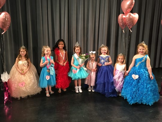 Contestants for Dainty Miss Heart of Hope, the 4 to 5 year old division, posed for pictures after being presented with their crowns and other pageant awards.