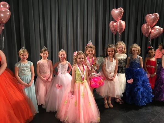 Contestants for Little Miss Heart of Hope, the 5 to 6 year old division, posed for pictures after being presented with their crowns and other pageant awards.