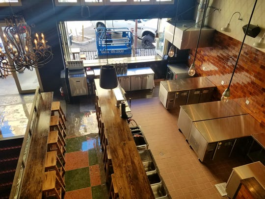 An aerial view of the main floor inside the downtown Phoenix location of Cornish Pasty Co.