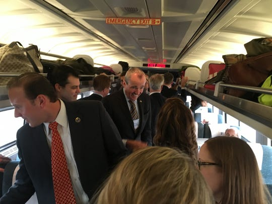 """Democrat Phil Murphy, a former U.S. ambassador to Germany running for governor, on board the """"Walk to Washington"""" train."""
