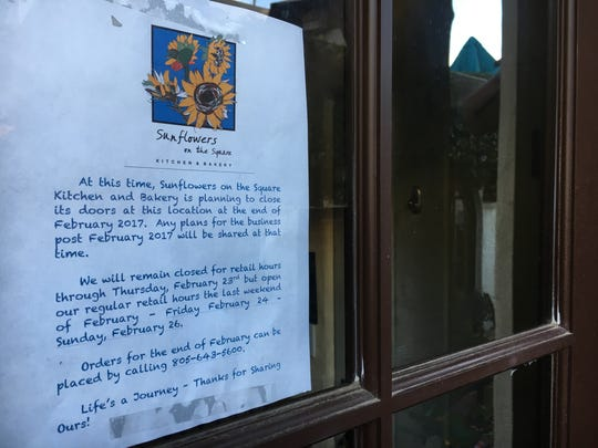 A note taped to the door at Sunflowers on the Square Kitchen & Bakery in downtown Ventura alerts patrons to its impending closure at the end of February.
