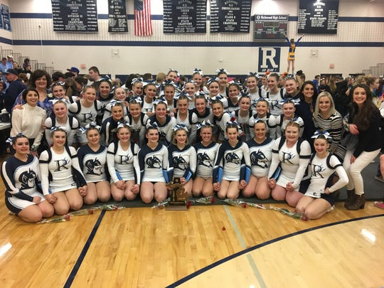 The Richmond High School cheer team poses for a photo after winning a Division 3 district title Friday.