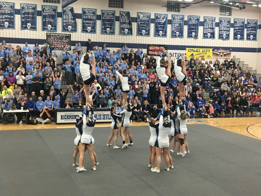 The Richmond High School cheer team performs its third routine Friday night.