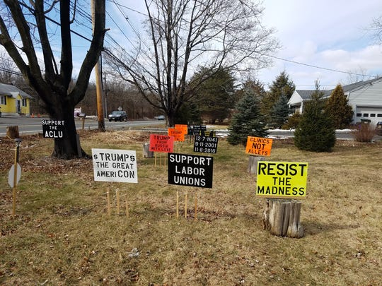 Some of the signs on Jim Girvan's front lawn.