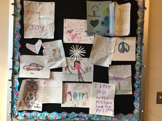 Student artwork hangs on a bulletin board in Katie Swartzendruber's office. She is a school counselor at Wilson Elementary School.