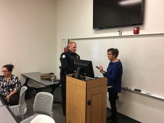 Police chief Darren Hooker chats with Clara Farah,