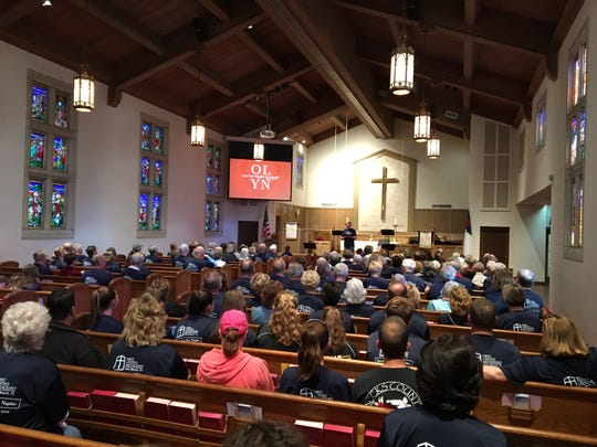 Church members pray together before going out to work in the community. Saturday, Feb. 11, for OLYN (Operation Love Your Neighbor) Day.