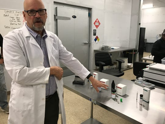Trulieve medical director Dr. Ken Brummel-Smith explains various products produced at Quincy plant.