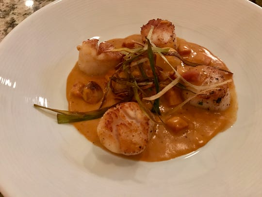 Scallops in a brandy-butter sauce with pancetta and Cipollini onions.
