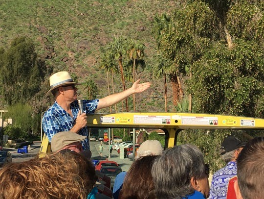 Charles Phoenix leads a bus tour during Palm Springs