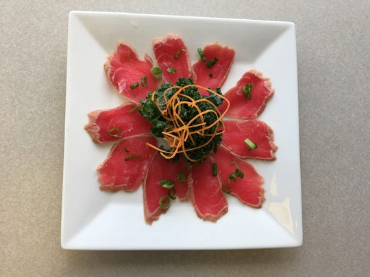 Tuna tataki is one of the popular dishes at Hideaway Grill & Sushi Bar.