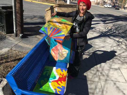 Ruidoso painter Whitney Hobson is putting paintings up for grabs in public spaces in the interest of sharing something positive in a contentious world.