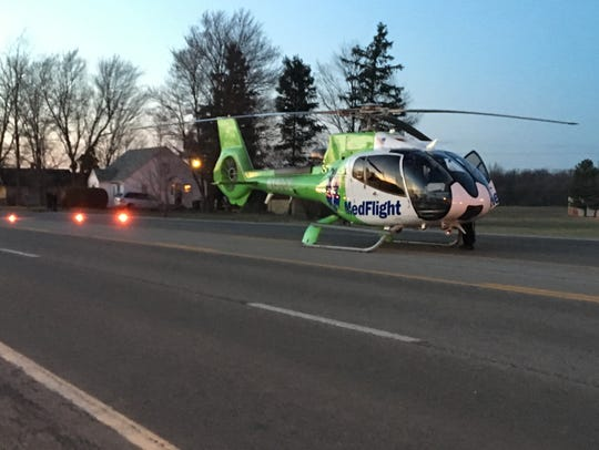 A MedFlight helicopter lands on Ohio 39 south of Shelby