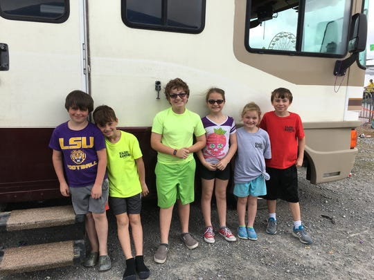 Enjoying the parade Tuesday from their camper at Cajun Field are Hunter Prejean, Brayden Bertrand, Landon Fontenot, Aubree Fontenot, Addisyn Fontenot and Camden Prejean.