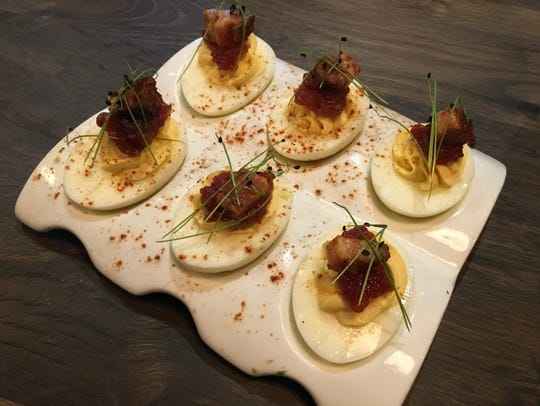 The bacon & eggs, deviled stuffed eggs, tomato jam and candied bacon, are on the appetizer menu for $7 at Public House in North Naples.