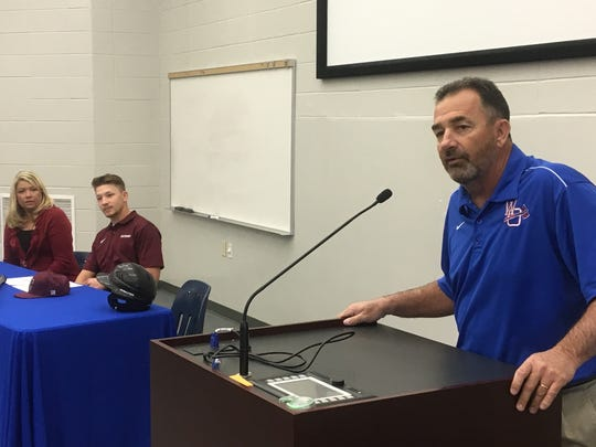 West Ouachita baseball coach Mitch Thomas (right) talks about his son Drew before he signs with Centenary.