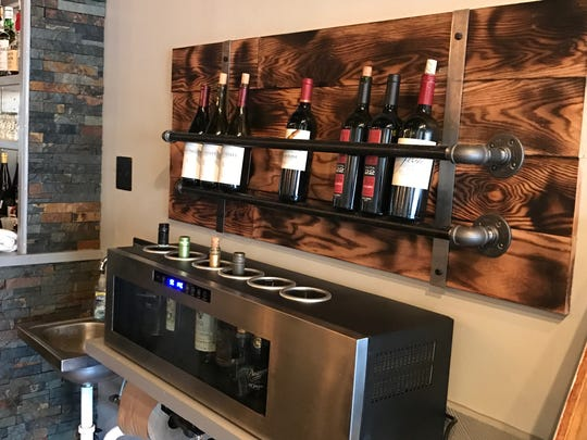 A new wine display containing woodwork owner Mitch Fletcher created with his family now hangs behind the bar at Vibe Bar & Grill.