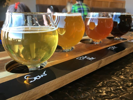 A flight of beers is served March 4, 2017, at Gilded