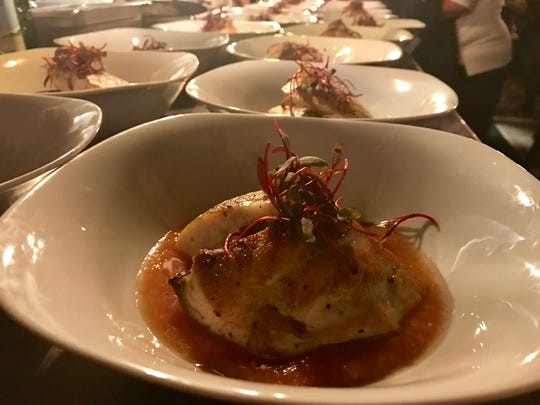 Finished plates of sea bass over tomato coulis await delivery at Animal House. On Sunday Chef Reuben Sliva recreated his James Beard House menu from 2006 for a packed dining room at Animal House in Cape Coral.