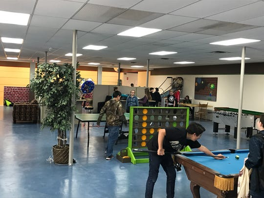 Teens play pool, ping-pong and other games at the Hive