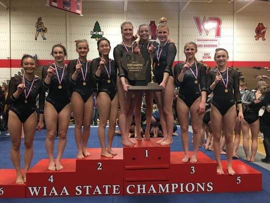 Franklin/Muskego/Whitnall/Oak Creek won its fifth state gymnastics title in six years. Members of the team are (from left)   Claire Maki, Emma Warr, Krystal Nelson, Rebecca Koronkowski, Kathryn Pecha, Isabelle Anderson, Abigail Missiaen, Elizabeth Missiaen and Mikayla Surprenant.