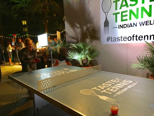 Bethannie Mattek-Sands, the No. 1 doubles player, has fun at the ping pong table at the the Taste of Tennis in Indian Wells. (March 6, 2017)