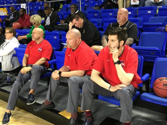 Oakland coaches (l-r) Troy Bond, Troy Crane and Tyler Soffiantino observe the TSSAA boys state tournament draw at MTSU's Murphy Center Tuesday.