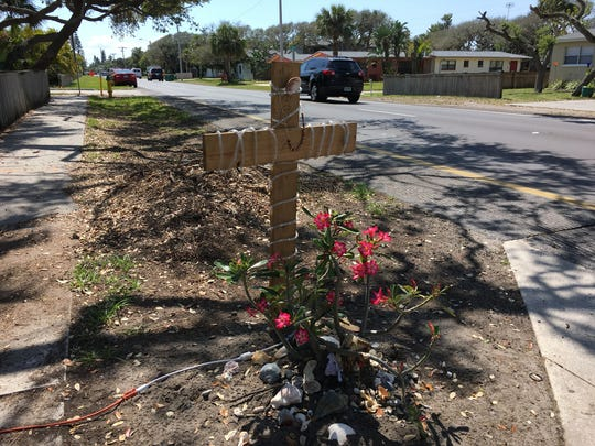 A cross was erected on the east shoulder of South Orlando Avenue in Cocoa Beach where Brian Holley was killed by a car Thursday.