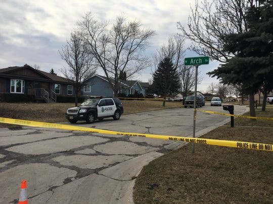 Police establish a perimeter March 11, 2017, near a domestic-violence shooting involving a Milwaukee police officer.