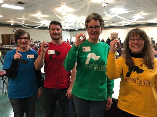 Volunteers show that the Paws & Pancakes breakfast