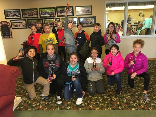 Members of the Pleasant Hill Elementary student council group recently visited with residents at The Shores, a senior living center in Pleasant Hill.