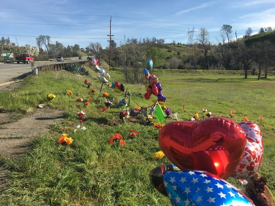 Family and friends of the man killed in a crash Friday on North Market Street left flowers and other items in a memorial near the crash site.