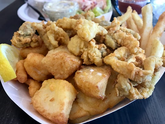 The Captain's Platter features a little bit of fried everything (scallops, shrimp, Ipswich clams, haddock, french fries) at Doug's.