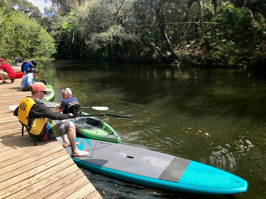 Visitors get ready to take their watercrafts out on the Estero River.