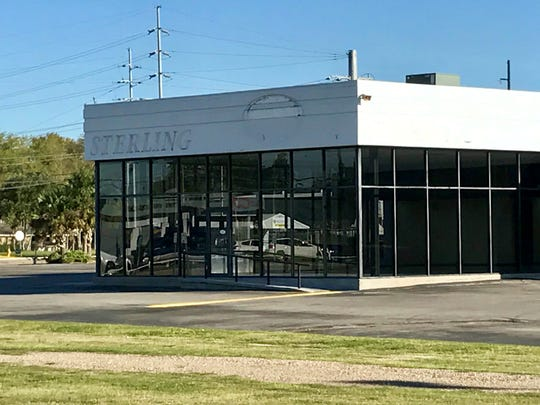 The former KIA building at 1111 N. University Ave. will soon be the new headquarters for Motor City vehicles, currently located at 1909 Johnston St.