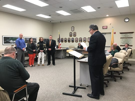 "James Hager, LRHSD business administrator and board secretary (right), addresses the Cherokee High School ""Heroes."" The four -- Gary Denelsbeck (left, blue shirt) Karen Hengst, Felicia Progar and Jeff Wood -- are shown listening to words that were honoring them for their life-saving actions."