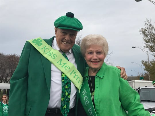 Art and Sue Clancy pose atop their St. Patrick's Day Parade float on Friday, March 17, 2017. The two are celebrating their 61st wedding anniversary as co-grand marshals for the parade.