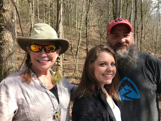 Benny Braden, from right, stands with his wife Ashley, and Sharon Spezia at the end of his record breaking hike of about 900 miles in 76 days. Spezia held the previous record, finishing the Great Smoky Mountains National Park Trails in four months and twelve days.