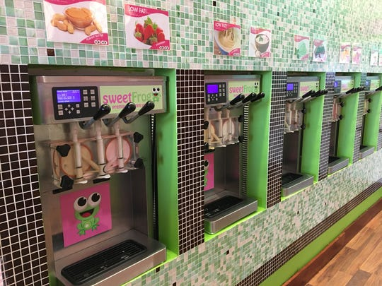 The self-serve machines for frozen yogurt at sweetFrog
