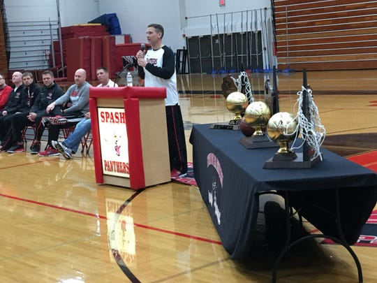 Scott Anderson, SPASH boys basketball coach, speaks during a celebration at the SPASH Fieldhouse on March 19, 2017.