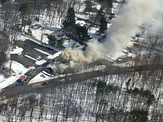 This aerial photo shows smoke billowing from Joseph's Steakhouse in Hyde Park.