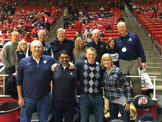 John (front row, first on left) and a Butler contingent that included athletic director Barry Collier (far right) before a game earlier this season.