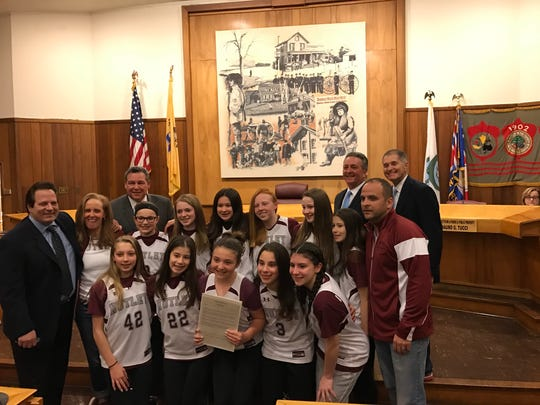 The Nutley Board of Commissioners honor the Parks and Recreation Department's seventh-grade girls basketball team on March 21, 2017.