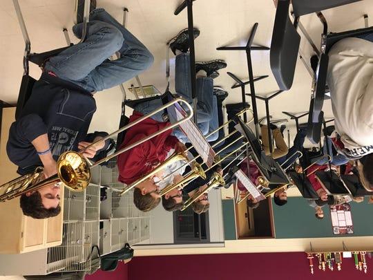 Trombone players Grant Petik, TJ Vandergrinten, Kyle