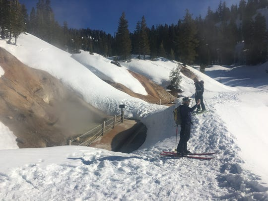 A pair of skiers check out the Sulfur Works at Lassen Volcanic National Park on March 12, 2017.