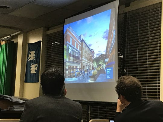 Audience members get a glimpse of the vision for the public plaza and surrounding buildings.