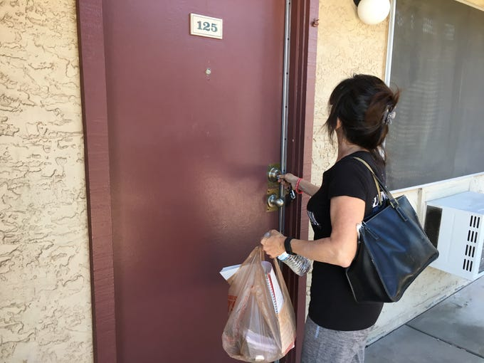Katrina Taylor locks the door to Apartment 125.