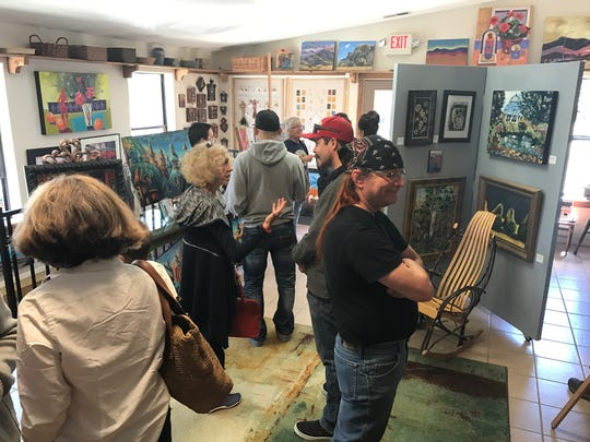 Crowds flocked to see the paintings of artist Kathleen Cotton at Art Ruidoso Gallery.