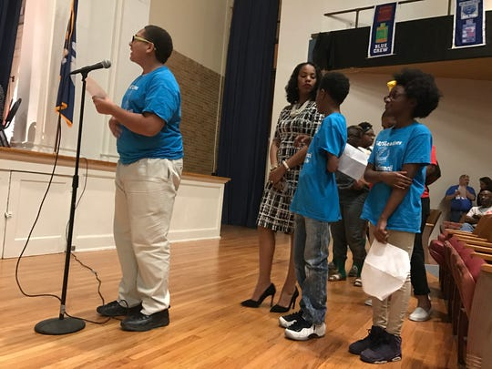 Arthur F. Smith honor students speak on behalf of their school, which would be merged with Peabody Magnet High School if board members approve recommendations by the superintendent.