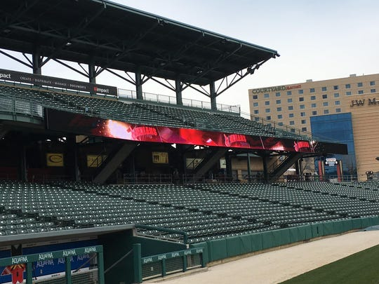 The ribbon board along the third base line. One of two installed at Victory Field.
